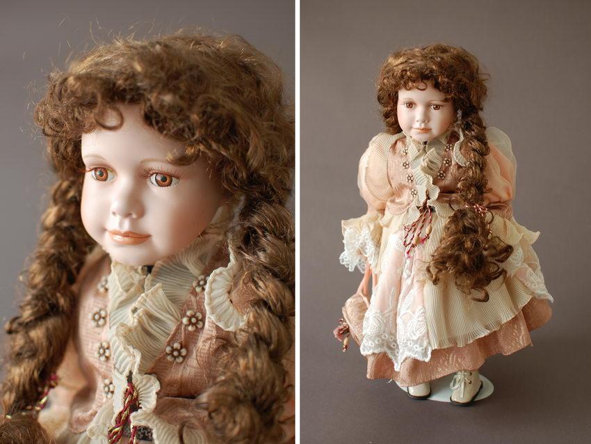 фарфоровая кукла с длинными косами
