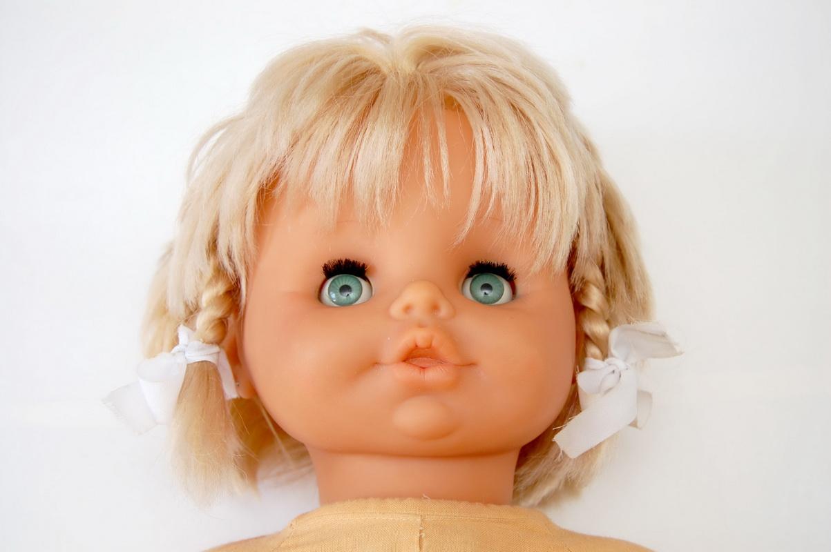 голова резиновой куклы