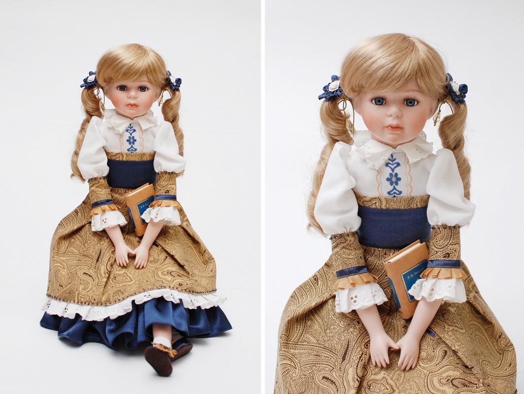 фарфоровая кукла в новом костюме